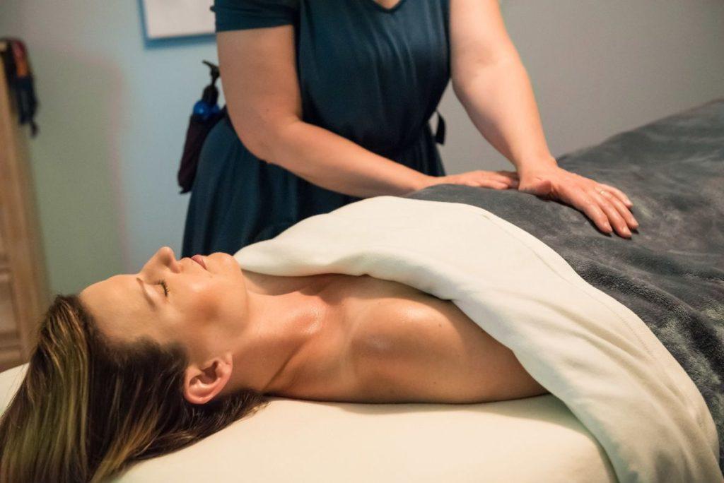 Client receiving reiki healing from Karen Asubury, LMT Vancouver, WA near Portland, OR